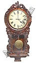 AN EARLY VICTORIAN WALNUT CASED WALL CLOCK having