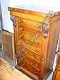 A VICTORIAN MAHOGANY AND WALNUT SECRETAIRE WELLINGTON CHEST fitted 7 drawers on a platform base, 25 1/2in. wide, 47 1/4in. high