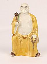 A CHINESE PORCELAIN FIGURE of an Immortal with ye