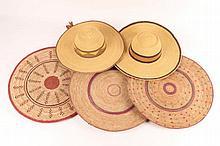 TWO FULANI STRAW HATS and three straw flat basket