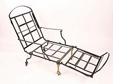 A VICTORIAN BLACK PAINTED AND BRASS FOLDING CAMPA