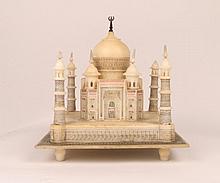 AN ALABASTER MODEL of the Taj Mahal on a decorati