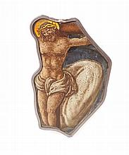 A STAINED GLASS FRAGMENT depicting Christ on the