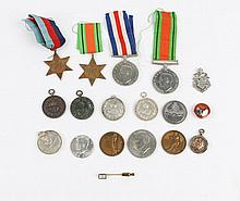 A GROUP OF FOUR WORLD WAR II MEDALS together with