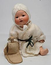 A GERMAN ARMAND MARSEILLE bisque headed doll, impr