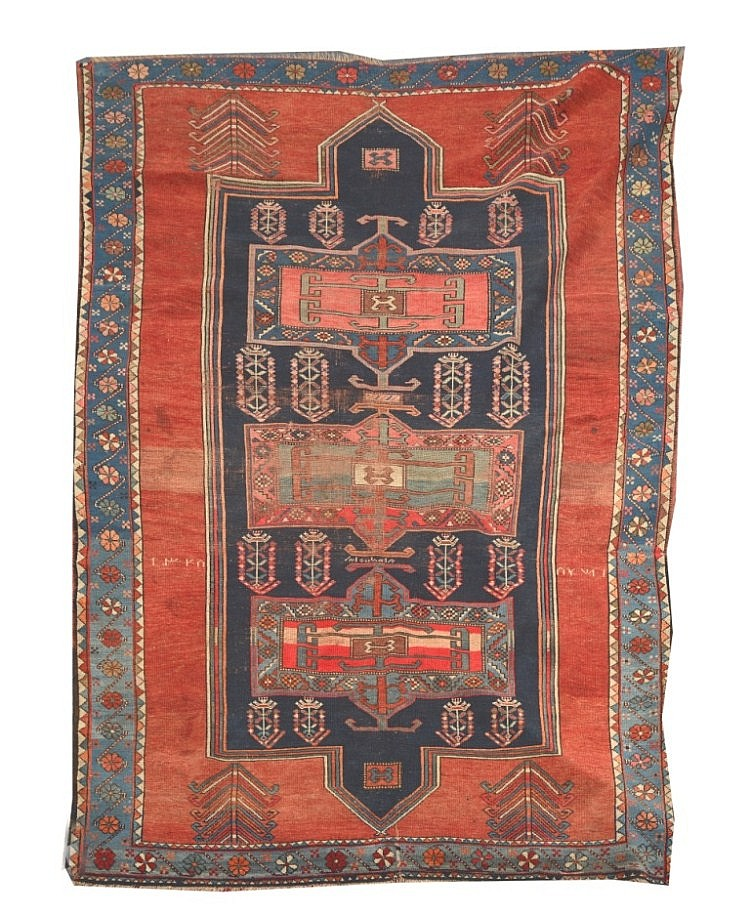 A KASAK RED GROUND RUG, the central blue ground