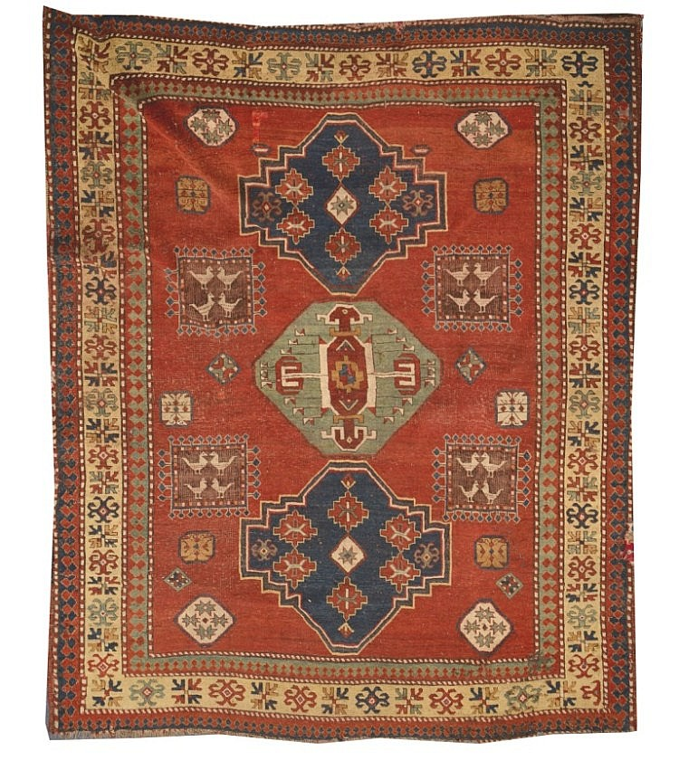 A KASAK RED GROUND RUG decorated a central