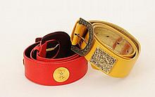 A red leather Yves Saint Laurent belt, decorated with YSL embossed gilt metal discs; and a yellow leather belt by Mondi,