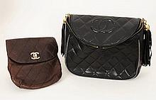 A Chanel bag with curved top embossed with CC logo, quilted leather, double zip fastening, zips with gilt metal ball and
