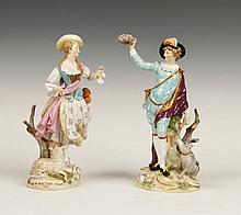 A PAIR OF MEISSEN PORCELAIN FIGURES of a boy and a