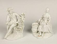 A PAIR OF VIENNA WHITE GLAZED PORCELAIN FIGURES of