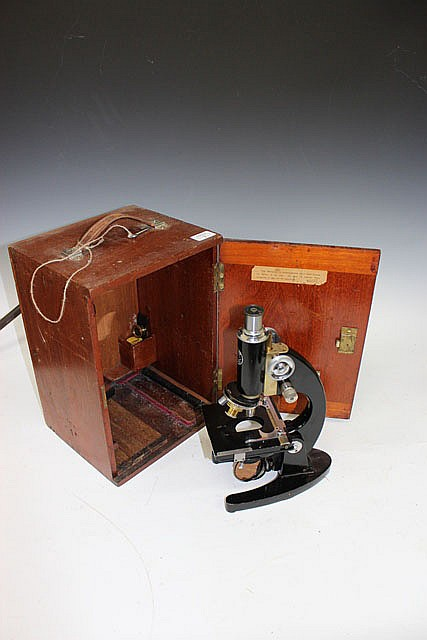 A 1950'S MICROSCOPE by Baker of London in a fitted