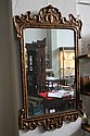 A GILTWOOD WALL MIRROR in the George III style,