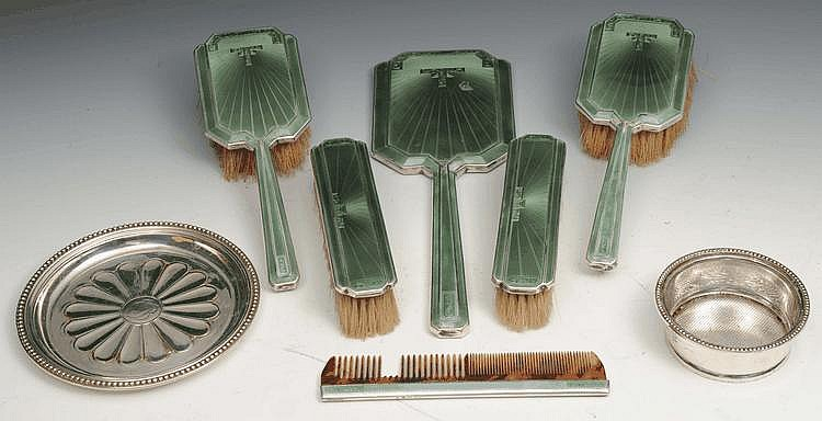 AN ART DECO SILVER AND ENAMEL DRESSING TABLE