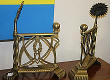 A PAIR OF ARTS AND CRAFTS BRASS FIRE DOGS, each w