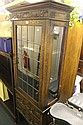 AN EDWARDIAN OAK DISPLAY CABINET of full height,