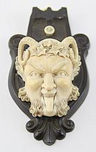 ANTIQUE IVORY SATYR ATTACHED TO WOODEN PLAQUE