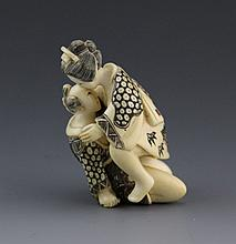 ANTIQUE IVORY EROTIC POLYCHROME NETSUKE