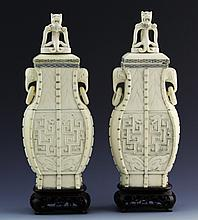 PAIR LIDDED IVORY URNS DRAGON & MEADERING MOTIF