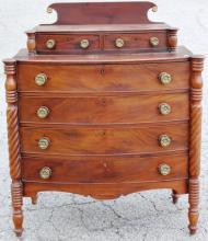 AMERICAN FEDERAL BOW-FRONT CHEST, CARVED COOKIE