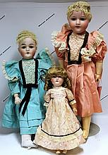 THREE ARMAND MARSEILLE DOLLS WITH BISQUE HEADS