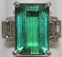 WHITE GOLD AND GREEN TOURMALINE AND DIAMOND RING;