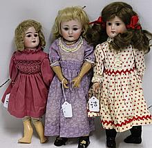 THREE GERMAN BISQUE HEAD DOLLS, ONE HEUBACH
