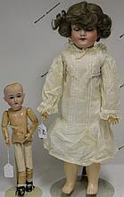 TWO GERMAN BISQUE HEAD DOLLS, ONE KESTNER,