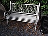 Cast Metal Garden Bench with Scrolled Decorations