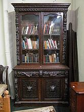 Antique Profusely Carved Oak Two Door Bookcase