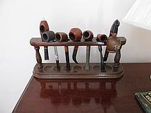 Collection of Seven Wooden Pipes on Stand
