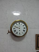 Antique Circular Brass Bound Ships Clock Mounted