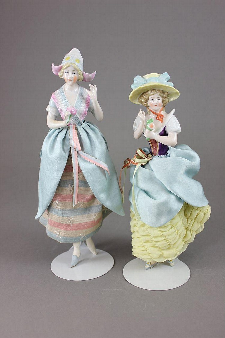 PAIR OF PINK TINT CHINA HALF-DOLLS WITH PAINTED MOLDED HATS AND BODICES, ARMS AWAY AND RETURNING