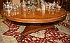 A LARGE CIRCULAR BURR WOOD DINING TABLE, in the