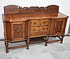 AN OAK SIDEBOARD, of inverted breakfront outline,