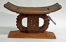 AN INTRICATELY CARVED TRADITIONAL CHIEF'S STOOL,