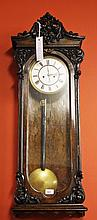 AN ATTRACTIVE VICTORIAN WALNUT WALL CLOCK, with