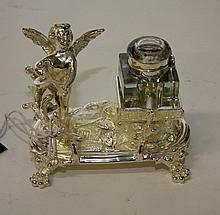 AN ORNATE SILVER PLATED INK STAND, modelled with a