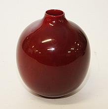 A ROYAL DOULTON FLAMBE PORCELAIN VASE, of bulbous