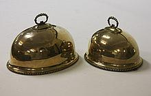 A SET OF TWO OVAL SILVER PLATED DISH COVERS, each