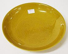 A CIRCULAR CHINESE MUSTARD COLOURED DISH, incised