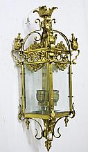 A HEAVY CAST BRASS HALL LANTERN, with four glass
