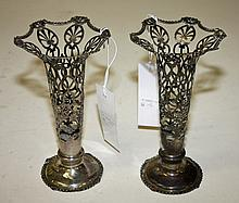 A PAIR OF SILVER OPENWORK VASES, each of trumpet