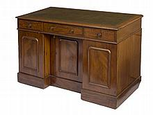 A VICTORIAN MAHOGANY KNEEHOLE DESK, the
