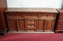 A MEXICAN SIDEBOARD, the moulded top with a