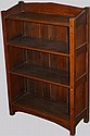 Arts & Crafts oak open front bookcase on arched