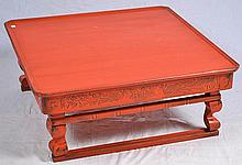 A CHINESE RED MARCH AND TRAVEL FOLDING TABLE.