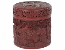CARVED CINNABAR AND ENAMEL BOX AND COVER Of cylindrical shape