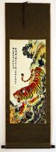 Chinese Embroidered hanging scroll , the textile embroidered with a motif of tiger down the mountain.