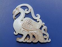 A Chinese white jade carving of a ho-ho bird, 3.25